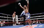 "April 16, 2011, Bayamon ,Puerto Rico ---  Orlando Salido(R) stops Juan Manuel ""Juanma"" Lopez  in the 7th round at the Ruben Rodriguez Coliseum in Bayamon, Puerto Rico.  --- Photo Credit : Chris Farina - Top Rank  (no other credit allowed)  copyright 2011 ."
