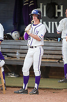 Chris Clare (9) of the High Point Panthers waits for his  turn to bat against the Coastal Carolina Chanticleers at Willard Stadium on March 15, 2014 in High Point, North Carolina.  The Panthers defeated the Chanticleers 11-8 in game two of a double-header.  (Brian Westerholt/Four Seam Images)