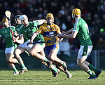 Colm Galvin of  Clare  in action against Kyle Hayes and Seamus Flanagan of  Limerick during their NHL quarter final at the Gaelic Grounds. Photograph by John Kelly.