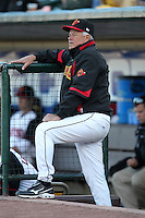 Rochester Red Wings coach Bobby Cueller #25 watches from the dugout during a game against the Louisville Bats at Frontier Field on May 9, 2011 in Rochester, New York.  Rochester defeated Louisville by the score of 7-6 in a marathon 18 inning game.  Photo By Mike Janes/Four Seam Images
