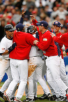 The USA team celebrates during the World Baseball Championships at Angel Stadium in Anaheim,California on March 12, 2006. Photo by Larry Goren/Four Seam Images