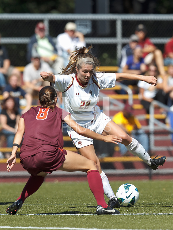 Boston College defender McKenzie Meehan (22) dribbles in close quarters.Virginia Tech (maroon) defeated Boston College (white), 1-0, at Newton Soccer Field, on September 22, 2013.
