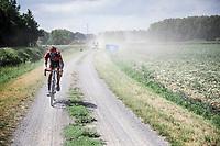 Pauwels Sauzen Vastgoedservice rider chasing the peloton. <br /> <br /> Dwars Door Het Hageland 2020<br /> One Day Race: Aarschot – Diest 180km (UCI 1.1)<br /> Bingoal Cycling Cup 2020