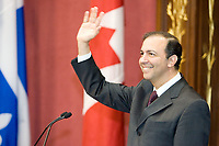 Quebec City, April 18, 2007 - Sam Hamad wave to the crowd as he his sworn in as the new Emploi et SolidaritÈ sociale minister at the Red room of the National assembly in Quebec City April 18, 2007. The cabinet is one of the smallest of the recent years and includes an equal number of men and women.<br /> <br /> PHOTO :  Francis Vachon - Agence Quebec Presse