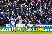 Crystal Palace's defender James Tomkins (5) celebrates in front of the Crystal Palace fans in the South stand during the EPL - Premier League match between Huddersfield Town and Crystal Palace at the John Smith's Stadium, Huddersfield, England on 17 March 2018. Photo by Stephen Buckley / PRiME Media Images.