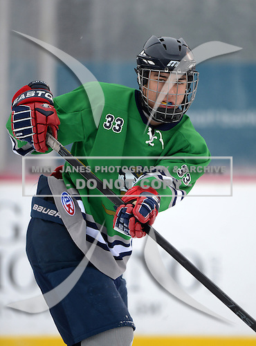 Notre Dame Fighting Irish of Batavia defensemen Cole Hudson (33) during warmups before a varsity ice hockey game against the Brockport Blue Devils during the Section V Rivalry portion of the Frozen Frontier outdoor hockey event at Frontier Field on December 22, 2013 in Rochester, New York.  (Copyright Mike Janes Photography)