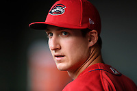 Third baseman Michael Osinski (17) of the Greenville Drive waits in the dugout before a game against the Rome Braves on Saturday, April 14, 2018, at Fluor Field at the West End in Greenville, South Carolina. Rome won, 4-0. (Tom Priddy/Four Seam Images)