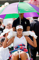 29-6-09, England, London, Wimbledon, Ana Ivanovic stays cool with a parasol and cold towels around her neck