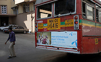 Bus with advertising for Uninor on a street in Mumbai. Telenor warned it could be forced to reconsider its presence in India if the New Delhi revises the terms of its spectrum licence amid a political scandal over regulation of the Indian telecoms industry.<br /> <br /> Unitech, since renamed Uninor, is one of five companies alleged to have benefited from irregularities that an official audit claimed had cost the Indian government $39bn in lost revenues from spectrum licences. <br /> <br /> Further reading : http://www.ft.com/cms/s/0/f391ebb0-33b4-11e0-b1ed-00144feabdc0.html#axzz1DWW1eUZh