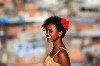 Portrait of beautiful young black woman at Complexo do Alemao, Rio de Janeiro favela. Since 2012 the area has operations of the Pacifying Police Unit ( Unidade de Policia Pacificadora, also translated as Police Pacification Unit ), abbreviated UPP, a law enforcement and social services program which aims at reclaiming territories, more commonly favelas, controlled by gangs of drug dealers.