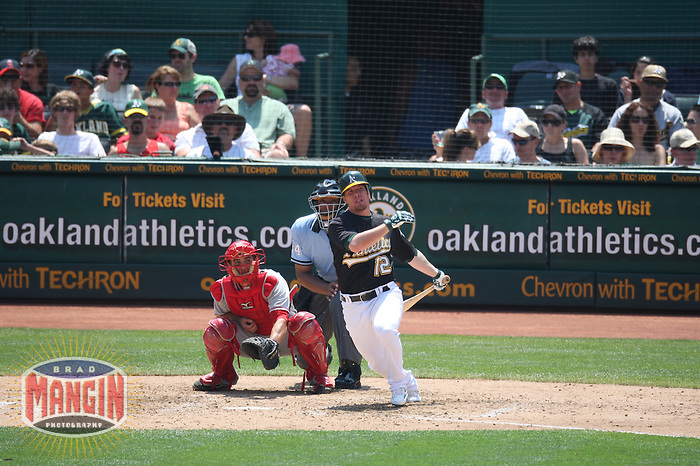 OAKLAND, CA - JULY 13:  Donnie Murphy of the Oakland Athletics bats during the game against the Los Angeles Angels of Anaheim at the McAfee Coliseum in Oakland, California on July 13, 2008.  The Angels defeated the Athletics 4-3.  Photo by Brad Mangin