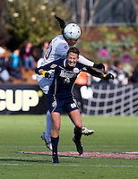 Mariah Nogueira (20) of Stanford goes up for a header against Mandy Laddish (2) of Notre Dame during the final of the NCAA Women's College Cup at WakeMed Soccer Park in Cary, NC.  Notre Dame defeated Stanford, 1-0.
