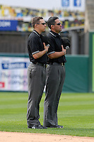 International League Umpire's Adam Hamari(left) and Manny Gonzalez(right) during a game between the Pawtucket Red Sox and Toledo Mud Hens on May 1, 2011 at McCoy Stadium in Pawtucket, Rhode Island. Photo by Ken Babbitt/Four Seam Images.
