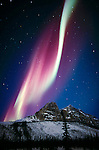 Aurora borealis, Brooks Range, Alaska, USA<br /> The aurora borealis is an atmospheric phenomenon that occurs as electrically charged particles from the sun make gases glow in the upper atmosphere. The Brooks Range in Alaska lies within the Arctic Circle and thus provides a more predictable chance to see the aurora borealis.