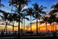 Sunset draws people's attention at Queen's Beach along Kalakaua Avenue in Waikiki, Honolulu, O'ahu.