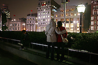 CHINA. Shanghai. Tourists along the Bund. Shanghai is a sprawling metropolis or 15 million people situated in south-east China. It is regarded as the country's showcase in development and modernity in modern China. This rapid development and modernization, never seen before on such a scale has however spawned countless environmental and social problems. 2008.