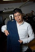 MAY 16, 2014 - KOJIMA, KURASHIKI, JAPAN: Yasuhiro Oshima, Betty Smith CO. president pose for camera at the Betty Smith shop. (Photograph / Ko Sasaki)