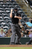Umpire Ryan Benson makes a call during a game between the Tampa Yankees and Fort Myers Miracle on April 15, 2015 at Hammond Stadium in Fort Myers, Florida.  Tampa defeated Fort Myers 3-1 in eleven innings.  (Mike Janes/Four Seam Images)