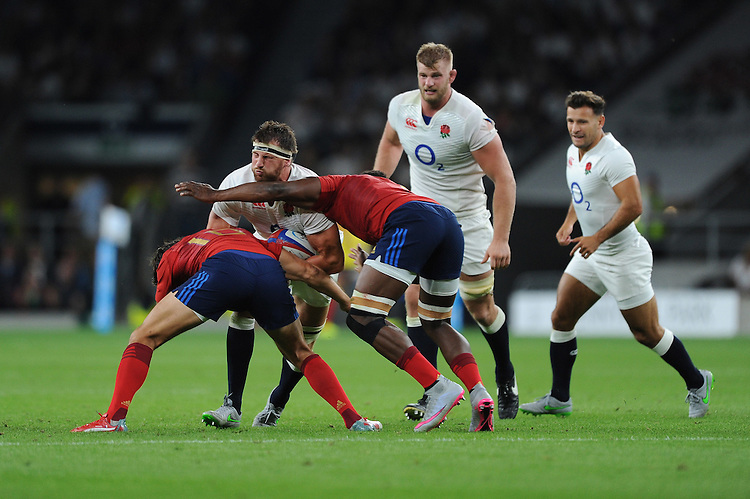 Tom Wood of England is tackled by Francois Trinh-Duc and Fulgence Ouedraogo of France - 15/08/2015 - Twickenham Stadium - London <br /> Mandatory Credit: Rob Munro/Stewart Communications