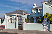 South Africa, Cape Town, Athlone Suburb.  Security Alarm Wires atop Wall Surrounding Upper-class House.