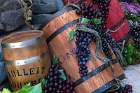 Wine barrel and grape display.