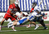 Sam Payton (32) stretches for the ball, past the check of Will Yeatman (23) of Maryland during the Face-Off Classic in at M&T Stadium in Baltimore, MD