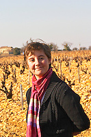 Amelie Barrot owner of Chateau des Fines Roches in the vineyard in Chateauneuf-du-Pape, Vaucluse, Rhone, Provence, France
