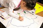Elementary school Grade 3 social studies geography girl working on map