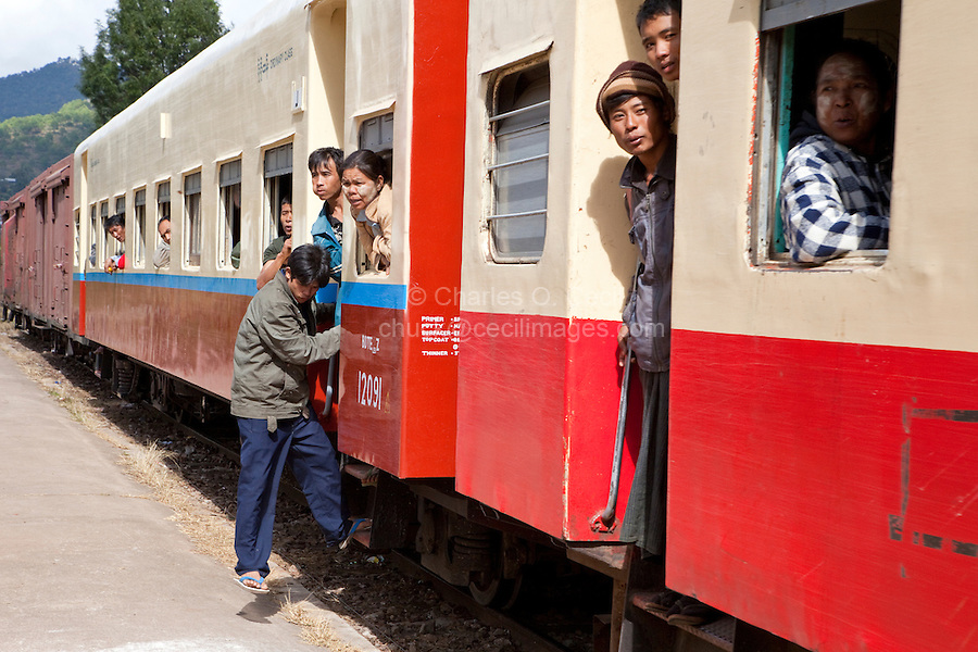 Myanmar, Burma.  Passengers on Train Arriving at Kalaw Train Station.