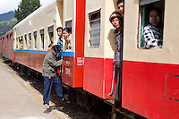Myanmar, Burma.  Passengers on Train Arriving at Kalaw Train Station.