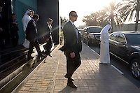 The NATO Secretary General Anders Fogh Rasmussen, flanked by security, leaves the Arabic service building on a visit to news channel Al Jazeera in Doha.