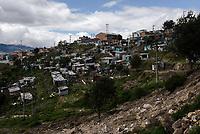 BOGOTA - COLOMBIA, 29-05-2020: Vista general de las casas que aún quedan en pie en el barrio Altos de La Estancia, después de los desalojos masivos del 2 de mayo de 2020 pasado. Mas de 200 familias terminan el proceso de desalojo en el predio La Estancia al sur de Bogotá quedando sin ninguna ayuda ni un techo donde vivir durante la cuarentena total en el territorio colombiano causada por la pandemia  del Coronavirus, COVID-19. / General view of the houses still standing in the Altos de La Estancia neighborhood, after the mass evictions of May 2, 2020. More than 200 families are evicted from La Estancia farm at south of Bogota city and they left withoput any help and shelter to live during total quarantine in Colombian territory caused by the Coronavirus pandemic, COVID-19. Photo: VizzorImage / Mariano Vimos / Cont