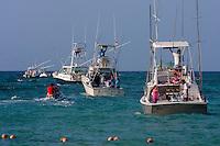 Jet Ski Taxiing Passengers from Shore to their Boats.  Playa del Carmen, Riviera Maya, Yucatan, Mexico.