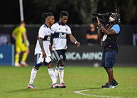 LAKE BUENA VISTA, FL - JULY 26: Yordy Reyna of Vancouver Whitecaps FC consoles Cristian Dájome of Vancouver Whitecaps FC after a missed penalty shot during a game between Vancouver Whitecaps and Sporting Kansas City at ESPN Wide World of Sports on July 26, 2020 in Lake Buena Vista, Florida.