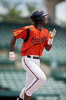 GCL Orioles shortstop Carlos Baez (1) runs to first base during a game against the GCL Rays on July 21, 2017 at Ed Smith Stadium in Sarasota, Florida.  GCL Orioles defeated the GCL Rays 9-0.  (Mike Janes/Four Seam Images)