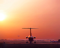Portland International Airport Jet on tarmac at sunset