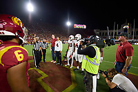 LOS ANGELES, CA - SEPTEMBER 11: Stanford Cardinal honorary captains Adam Keefe and Jimmy Klein join captains Michael Wilson #4, Jordan Fox #10, Thomas Booker #4 and Houston Heimuli #34 for the coin-toss before a game between University of Southern California and Stanford Football at Los Angeles Memorial Coliseum on September 11, 2021 in Los Angeles, California.