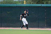 AZL White Sox right fielder Anthony Coronado (13) prepares to catch a fly ball during an Arizona League game against the AZL Diamondbacks at Camelback Ranch on July 12, 2018 in Glendale, Arizona. The AZL Diamondbacks defeated the AZL White Sox 5-1. (Zachary Lucy/Four Seam Images)