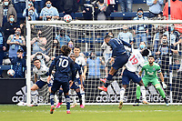 KANSAS CITY, KS - MAY 16: Khiry Shelton #11 Sporting KC heads  the ball towards the goal during a game between Vancouver Whitecaps and Sporting Kansas City at Children's Mercy Park on May 16, 2021 in Kansas City, Kansas.