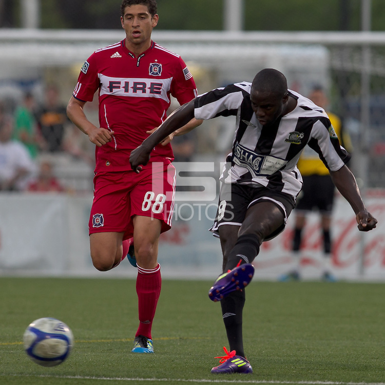 Rochester Rhinos forward Kendall Jagdeosingh (9) passes the ball. In a Third Round U.S. Open Cup match, the Chicago Fire defeated the Rochester Rhinos, 1-0, at Sahlens Stadium on June 28, 2011.
