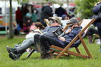 Sunday 25 May 2014, Hay on Wye, UK<br /> Pictured: People enjoy a read on the festival green.<br /> Re: The Hay Festival, Hay on Wye, Powys, Wales UK.