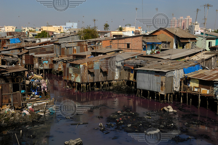 Slum housing built over heavily polluted and stagnant water in the south of the city.