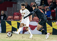 COLLEGE PARK, MD - NOVEMBER 21: Najim Romero #10 of Iona passes away from Brett St. Martin #12 of Maryland during a game between Iona College and University of Maryland at Ludwig Field on November 21, 2019 in College Park, Maryland.
