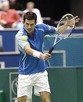23-2-06, Netherlands, tennis, Rotterdam, ABNAMROWTT, Tim Henman in action against Novak Djokovic
