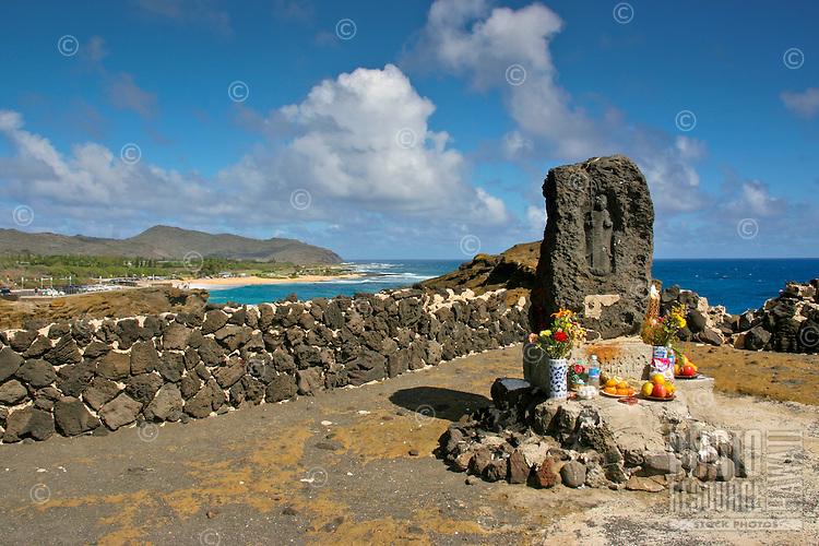 Japanese shrine rock god altar: a Japanese fishing shrine with a carving of a Japanese guardian god overlooking dangerous waterways along Kalaniana'ole Highway near Sandy Beach, East O'ahu.
