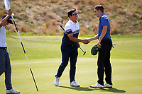 Dongwoo Kang shakes hands with Tom Parker. Day one of the Renaissance Brewing NZ Stroke Play Championship at Paraparaumu Beach Golf Club in Paraparaumu, New Zealand on Thursday, 18 March 2021. Photo: Dave Lintott / lintottphoto.co.nz