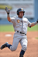 Charleston RiverDogs left fielder Michael O'Neill #10 runs to third during a game against the Asheville Tourists at McCormick Field July 26, 2014 in Asheville, North Carolina. The Tourists defeated the RiverDogs 9-6. (Tony Farlow/Four Seam Images)