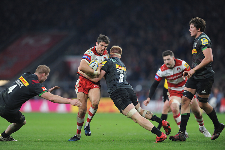 James Hook of Gloucester Rugby is tackled by Jack Clifford of Harlequins as George Merrick of Harlequins supports during the Aviva Premiership Rugby match between Harlequins and Gloucester Rugby at Twickenham Stadium on Tuesday 27th December 2016 (Photo by Rob Munro/Stewart Communications)