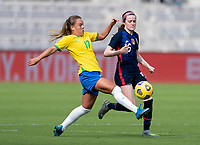 ORLANDO, FL - FEBRUARY 21: Andressinha #17 of Brazil defends Rose Lavelle #16L of the USWNT warms up during a game between Brazil and USWNT at Exploria Stadium on February 21, 2021 in Orlando, Florida.