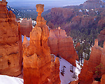 Bryce National Park, UT<br /> Morning light on Thor's Hammer and spring snow along the Navajo Trail